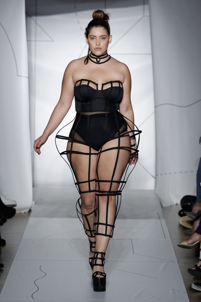 A catwalk model with curves, wearing a black leotard
